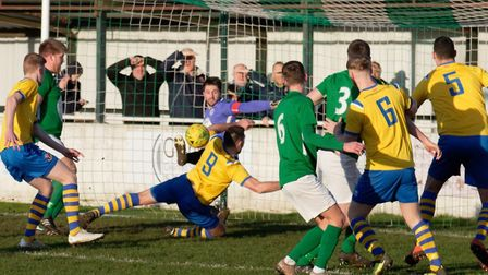AFC Sudbury (yellow shirts) in action last season, against Soham Town Rangers. Picture: PAUL VOLLER