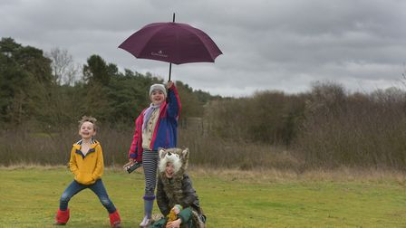 Thomas Howard, Milly Howard, Ruben and Leo Sedley having fun in Storm Dennis. Picture: SARAH LUCY B