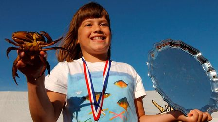 Champion crabber, Imogen Wiltshire of Holton near Halesworth, nine with her trophy after winning th