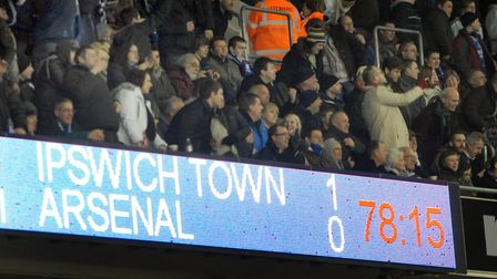 Happy days: the scoreboard says it at all at Portman Road, as Town claim a 1-0 win over Arsenal in t