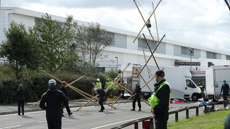 Emergency services dismantle the bamboo lock-ons used to block the road outside the Newsprinters pri
