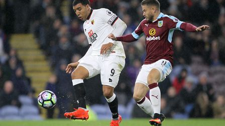 Watford's Troy Deeney (left) and Burnley's Michael Kightly battle for the ball during the Premier Le