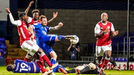 James Norwood volleys in a late shot towards goal, but his effort cannoned off Tolaji Bola in the ga