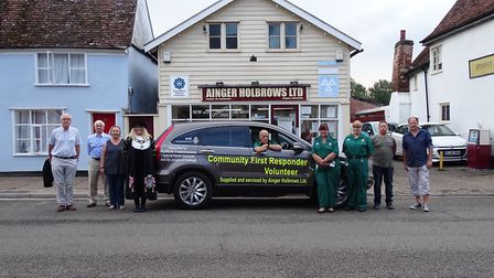 Pictured with the Hadleigh Community First Responders new vehicle, from left, John Curran, represent