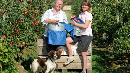 Henry Dobell and his partner Kate at the Moat Farm orchard Picture: Henry Dobell
