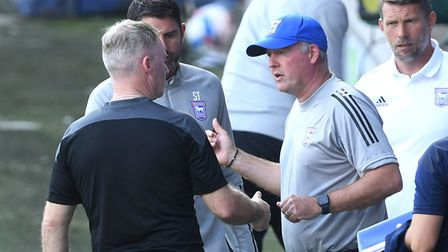 Ipswich Town manager Paul Lambert speaks to Wigan Athletic manager John Sheridan (left) on the touch