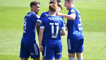 Ipswich Town's Gwion Edwards (obscured) celebrates with team-mates after scoring his side's second g