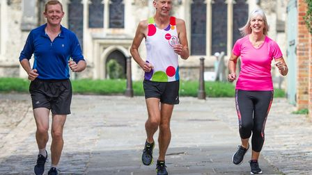 Stuart Service, centre, training for his virtual London marathon around Hadleigh, with two of those