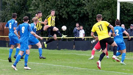 Josh Mayhew volleys a chance over the bar, during Stowmarket Town's 1-0 win over Gorleston. Stow tra