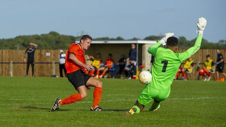 Ollie Hughes has this effort saved by Cogenhoe United keeper Bradley Lashley. Picture: NEIL DADY