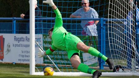 Halstead keeper Jack Cherry is beaten by Liam Jackson's 4th minute penalty during Leiston's 5-0 win