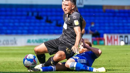 Teddy Bishop wins the ball as he tackles Gary Roberts.Picture: Steve Wallerwww.stephenw