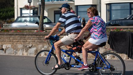 A couple enjoy a tandem bike ride Picture: SARAH LUCY BROWN