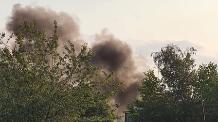 A fire has broken out in a pile of rubbish on the grounds of Stowmarket High School. Picture: RUSSEL