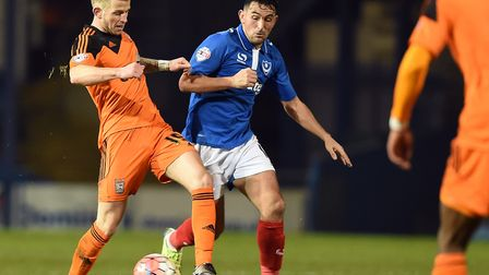 Gary Roberts, right, in action for Portsmouth against Ipswich Town's Luke Hyam, has re-signed for Wi