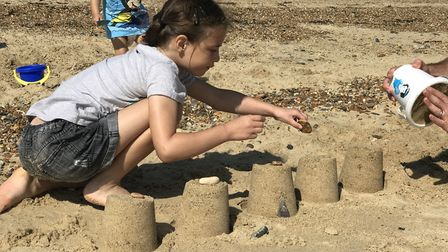 The Stamp children playing in the sand. Picture: Victoria Pertusa