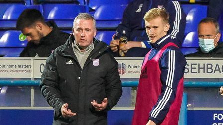 Ipswich Town manager Paul Lambert speaks with substitute Flynn Downes ahead of bringing him on again