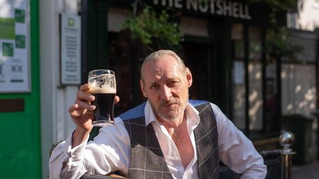 Nutshell regular Ian McCabe enjoying a pint now the pub can serve punters on the street Picture: SAR