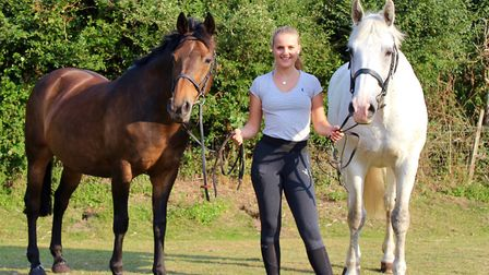 Georgie with horses Plum (left) and Peter (right) Picture: THE VEALE FAMILY