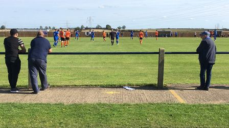 Fans observing social-distancing rules during Bury Town's FA Cup match at Cogenhoe United on the ope
