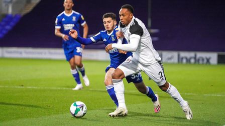 Armando Dobra battling with Kenny Tete during the recent Carabao Cup loss to Fulham. Photo: Steve Wa