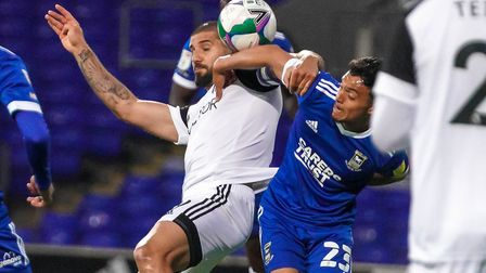 Andre Dozzell battles with Aleksandra Mitrovic, who broke the deadlock in the first half with a clin
