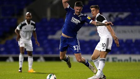 Ipswich Town's Oli Hawkins (left) and Fulham's Tom Cairney battle during Town's 1-0 Carabao Cup defe
