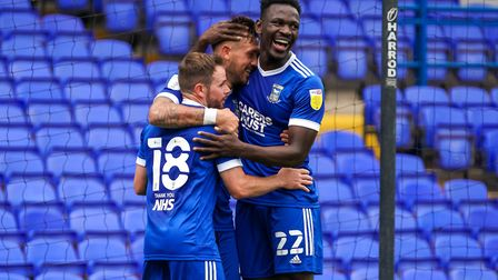 Luke Chambers is congratulated by Alan Judge and Toto Nsiala after his header put Ipswich Town 2-0 u