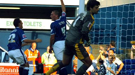 Jason de Vos puts his arm in the air after scoring Ipswich Town's first goal in a 4-1 home win over