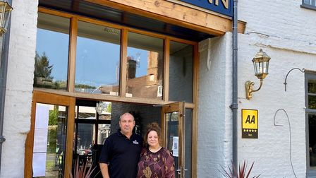 Cheryl Hickman and her fellow co-owner and partner Wayne outside the Bull Inn at Barton Mills. Pict