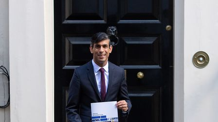 Chancellor of the Exchequer Rishi Sunak holds a copy of his Winter Economy Plan outside No 11 Downin