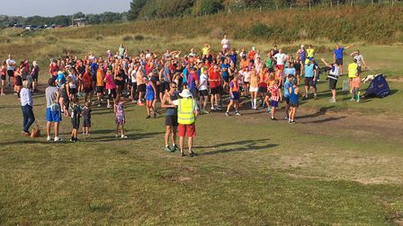 Happier times: runners and walkers assemble before the start of the weekly Sizewell parkrun. Picture