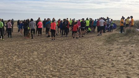 Runners and walkers congregate for the run briefing before the start of the Great Yarmouth North Bea