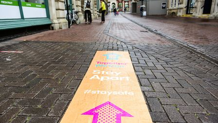 Signage with messages to stay apart have been laid on the pavements around Ipswich town centre Pictu