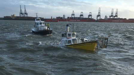 The wrecked Harwich Harbour Ferry being towed away by the Harwich Haven Authority Picture: COLIN KIN