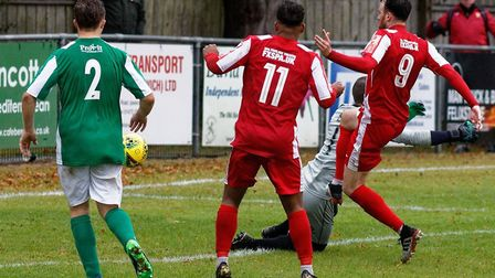 Ollie Canfer (Ni. 9) fires home his second goa during Felixstowe & Walton United's FA Trophy success