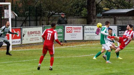 Ollie Canfer heads home the first of his brace of goals, against Great Wakering Rovers. Picture: PAU