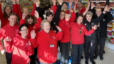 QD store manager Giles Andrew (pictured far right) and his team celebrating the Dereham's new look,
