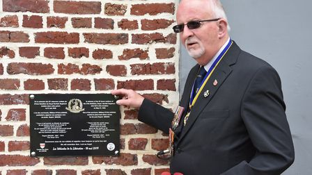 Dennis O'Callaghan with a memorial unveiled at the sight of the Le Paradis massacre. Picture: Suppli