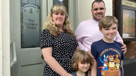Former owners of The George Pub in Dereham Rebecca and Gareth Williams with their sons Hayden and St