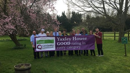 Staff show off their Good CQC Rating banner. Picture: Kingsley Healthcare