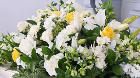 You can still arrange for flowers to travel in the hearse or be taken to the crematorium. Picture: G