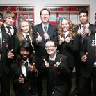 Improvements: David Dickson and his pupils smile for the camera after receiving a good Ofsted report