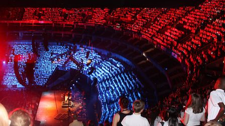 Some 6,000 children form a chorus at the Young Voices Concert in the O2 Arena