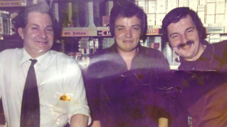 Mr Ronnie Lee (left), his son Michael Lee (middle) and Ronnie's brother Mick in the shop from 1978