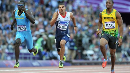 Great Britain's Adam Gemili (centre) in action with Jamaica's Yohann Blake (right) and Bahamas Derri