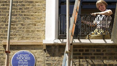 A blue plaque in north-west London commemorating sculptor Henry Moore.