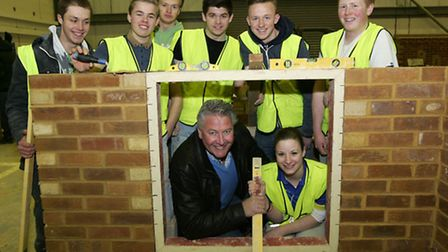 Tommy Walsh with students taking part in a construction competition at Barking and Dagenham College,