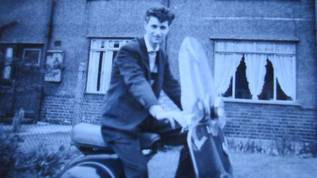 Bernie Lane on a scooter infront of his house in Dagenham