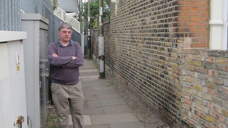 Colin Newman with the street light that was broken in the background. Pic: Richard Newman.
